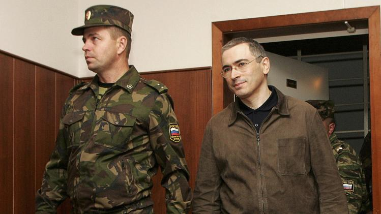 File photo of jailed Russian former oil tycoon Khodorkovsky in the defendants' cage during a court session in Moscow