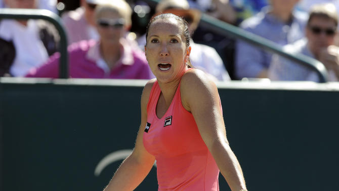 Jelena Jankovic of Serbia, talks to her coach during a semifinal match against Stefanie Voegele of Switzerland, at the Family Circle Cup tennis tournament in Charleston, S.C., Saturday, April 6, 2013. Jankovic won 6-4, 6-7 (6), 6-2.. (AP Photo/Stephen Morton)