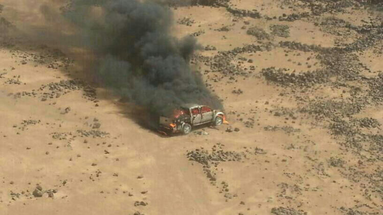 Handout photo of a pickup truck on fire after it was hit by a Jordanian warplane following failure to heed warnings not to cross into Jordan from Syria