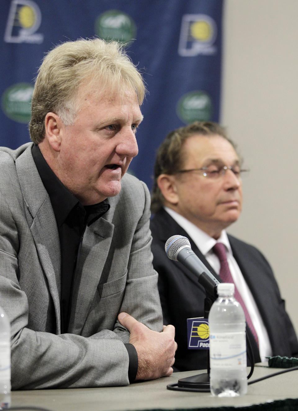 Larry Bird, left, talks about stepping down as president of the Indiana Pacers  as team owner Herb Simon listens during an announcement by the NBA basketball team in Indianapolis, Wednesday, June 27, 2012. Donnie Walsh was named as president and Kevin Pritchard as general manager. (AP Photo/Michael Conroy)