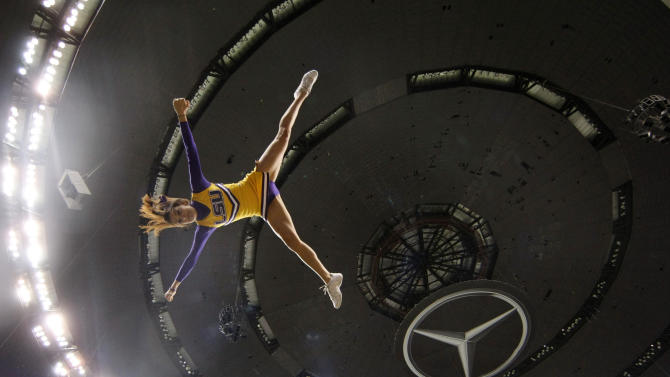 An LSU cheerleaders is flipped before the BCS National Championship college football game against Alabama Monday, Jan. 9, 2012, in New Orleans. (AP Photo/Gerald Herbert)