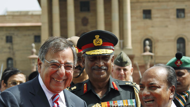U.S. Defense Secretary Leon Panetta, left, is greeted by Indian Defense Minister A.K. Antony in New Delhi, India, Wednesday, June 6, 2012. Panetta is urging leaders of India to play a more robust role in Afghanistan, as U.S. tensions with Pakistan, India's arch-rival, continue to churn. (AP Photo/Saurabh Das)