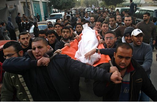 Palestinians carry the body of Issam al-Batch, 45, during his funeral in Gaza City, Thursday, Dec. 8, 2011. An Israeli airstrike on a car near a crowded park in downtown Gaza City killed two suspected militants on Thursday, the second such attack this week after a period of relative calm along the Israeli-Gaza border. (AP Photo / Hatem Moussa)