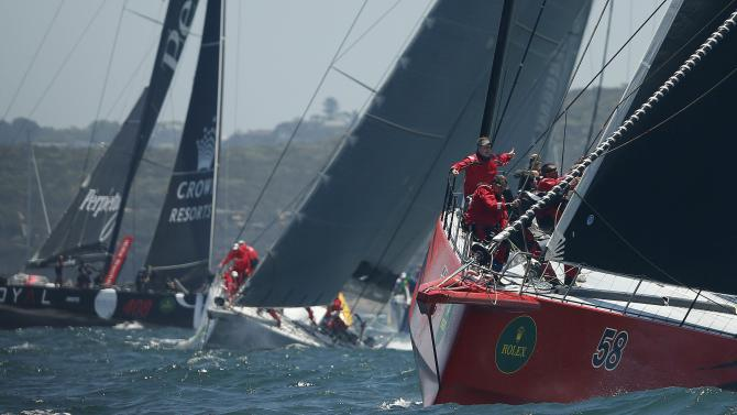 Comanche races out of Sydney Harbour followed by Wild Oats XI and Perpetual Loyal at the start of the Sydney to Hobart Yacht Race