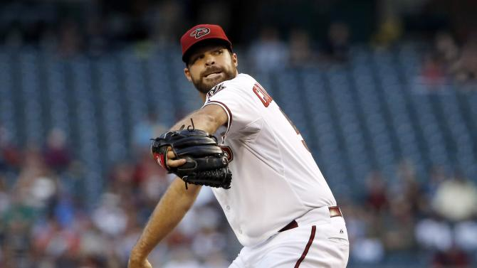 Arizona Diamondbacks' Josh Collmenter throws a pitch against the Pittsburgh Pirates during the first inning of a baseball game Friday, April 24, 2015, in Phoenix. (AP Photo/Ross D. Franklin)
