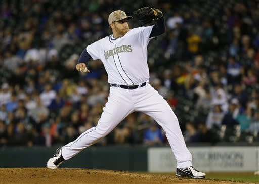 Harang 4-hitter leads Seattle past San Diego 9-0