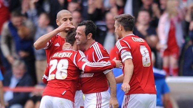 Andy Reid, centre, celebrates scoring Nottingham Forest's second goal