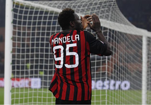 AC Milan's Sulley Muntari wears a jersey reading Mandela as he applauds supporters at the end of a Champions League, Group H, soccer match between AC Milan and Ajax at the San Siro stadium, in Mil