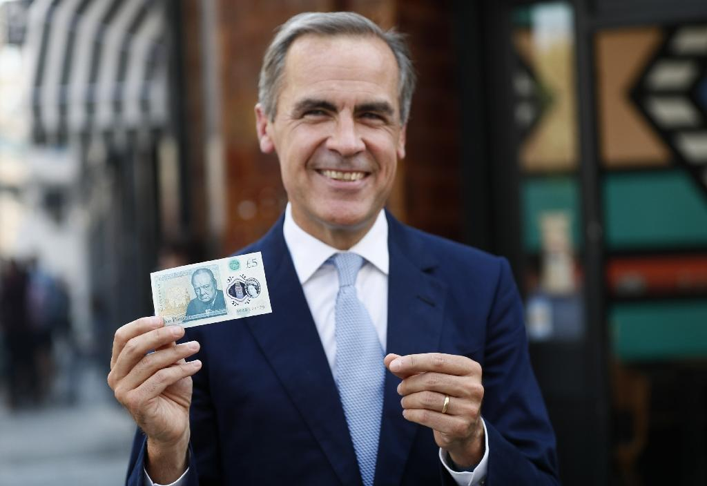 Bank of England begins corporate debt purchases