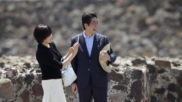 Japan's Prime Minister Abe laughs as Japan's first lady Akie takes a picture of Mexico's President Pena Nieto during a tour at the Teotihuacan archaeological site, on the outskirts of Mexico City