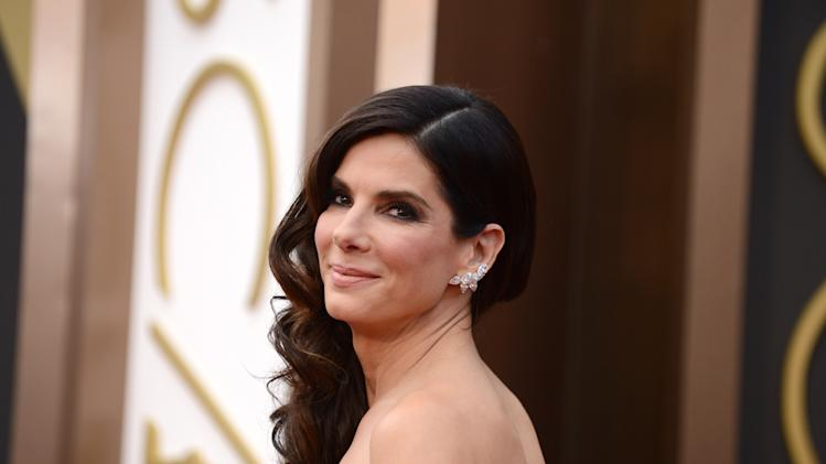 "FILE - In this March 2, 2014 file photo, Sandra Bullock arrives at the Oscars at the Dolby Theatre, in Los Angeles. Bullock's encounter with a stalker in her home reads like a scene from a scary movie in newly released documents, painting a portrait of an obsessed fan who described himself as her ""husband."" Bullock, who has portrayed brave, strong women on screen, took quick action, locking the door and summoning police. (Photo by Jordan Strauss/Invision/AP, file)"