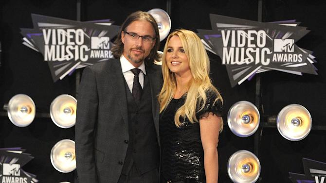 FILE - In this Aug. 28, 2011 file photo, Jason Trawick and Britney Spears arrive at the MTV Video Music Awards in Los Angeles.  A judge says Spears' one-time fiance Jason Trawick has resigned as her co-conservator on Friday Jan. 11, 2013. (AP Photo/Chris Pizzello, file)