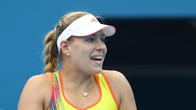 Angelique Kerber of Germany reacts to a line call in her 2nd round match against Monica Puig of Puerto Rico during the Brisbane International tennis tournament in Brisbane, Australia, Wednesday, Jan 2, 2013.  (AP Photo/Tertius Pickard)