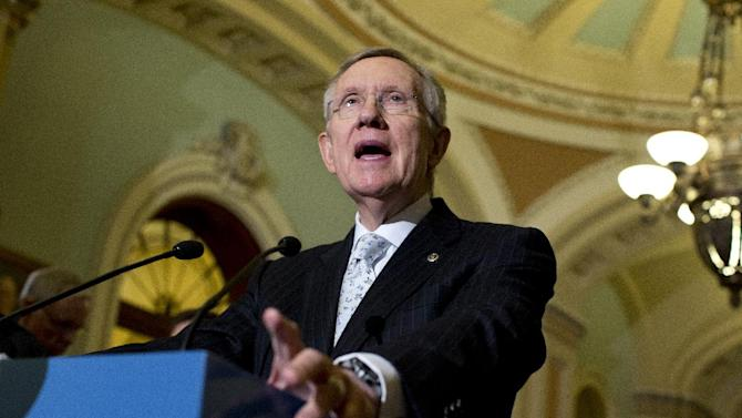 """Senate Majority Leader Harry Reid of Nev. gestures during a news conference on Capitol Hill in Washington, following the Democratic policy luncheon Tuesday, May 21, 2013. Despite years of hand-wringing in both parties, little progress has been made toward changing congressional rules on filibusters, senatorial """"holds"""" on presidential nominees and other stalling ploys.  (AP Photo/Evan Vucci)"""