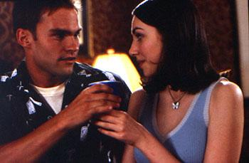Stifler ( Seann William Scott ) tries to convince his latest conquest ( Eden Riegel ) that he truly cares about her in Universal's American Pie