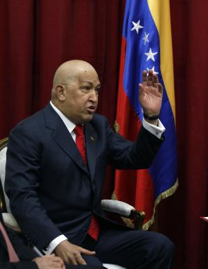 Venezuela's President Hugo Chavez gestures during a meeting with Russia's Foreign Minister Sergey Lavrov, unseen, in Caracas, Venezuela, Wednesday Aug. 24, 2011. (AP Photo/Fernando Llano)