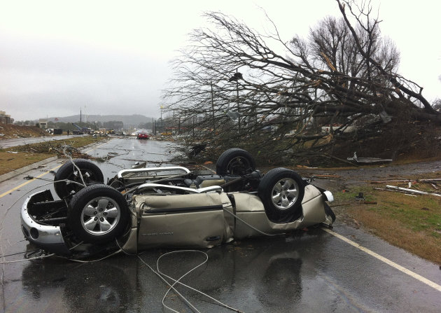 A vehicle lies on a road after a tornado moved through Adairsville, Ga. on Wednesday, Jan. 30, 2013. A fierce storm system that roared across northwest Georgia has left at least one person dead and a