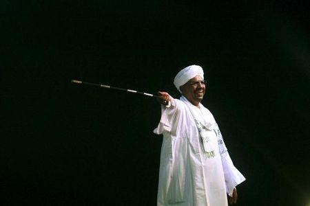 Sudan's President al-Bashir speaks to the crowd after a swearing-in a ceremony at green square in Khartoum