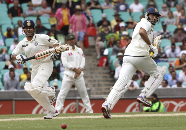 India's batsman Sachin Tendulkar left, and VVS Laxman run between the wicket on the fourth day of the second test match at the Sydney Cricket Ground in Sydney, Australia, Friday, Jan. 6, 2012.(AP Phot