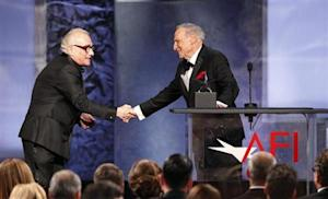 Producer Brooks is congratulated by director and presenter Scorsese after accepting the American Film Institute's 41st Life Achievement Award in Hollywood