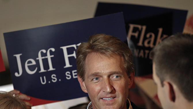 Arizona Republican Senate candidate and current U.S. Rep. Jeff Flake, R-Ariz., speaks at a primary election night party, Tuesday, Aug. 28, 2012, at his home in Mesa, Ariz. Early polling humbers have Flake ahead of his challenger, Wil Cardon,in his effort to fill retiring Sen. Jon Kyl's, R-Ariz, seat. (AP Photo/Matt York)