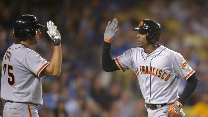 San Francisco Giants' Joaquin Arias, right, is congratuated by Barry Zito after hitting a solo home run during the third inning of the Giants' baseball game against the Los Angeles Dodgers, Tuesday, Oct. 2, 2012, in Los Angeles. (AP Photo/Mark J. Terrill)