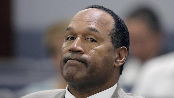 File-This Monday, Sept. 15, 2008,  file photo shows O.J. Simpson appearing in court  for opening statements on the first day his trial in Las Vegas. Simpson is heading back to the Las Vegas courthouse where he was convicted of leading five men in an armed sports memorabilia heist to ask a judge for a new trial because, he says, the Florida lawyer  botched his defense. (AP Photo/Jae C.Hong,File)