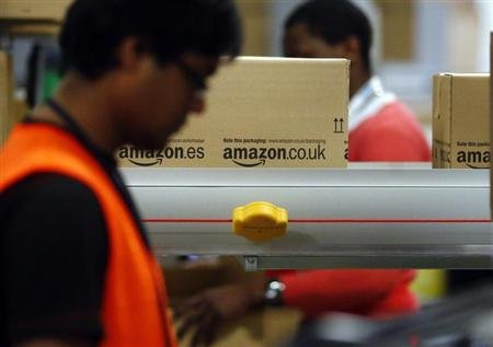 A worker packs boxes at Amazon&#39;s logistics centre in Graben near Augsburg December 17, 2012. REUTERS/Michael Dalder