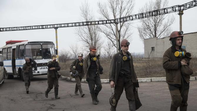 Miners arrive to help with the rescue effort in Zasyadko coal mine in Donetsk