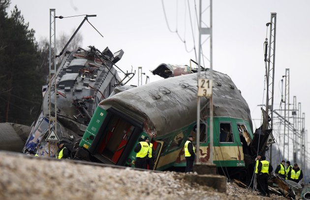 Polish emergency services personnel work at the site of a train crash near the town of Szczechociny