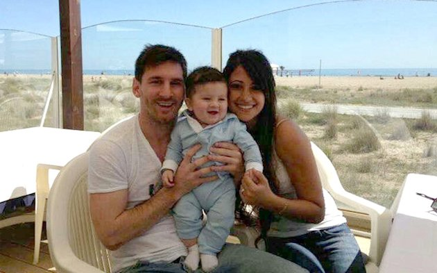 Lionel Messi with partner Antonella and son Thiago.