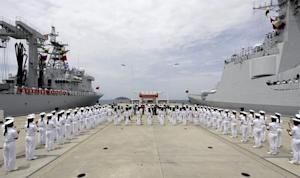 Chinese navy sailors stand in formation as they attend …