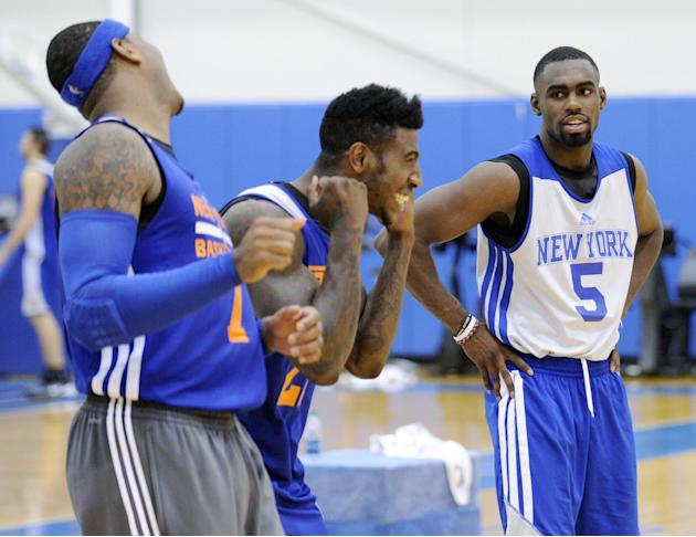 New York Knicks' Tim Hardaway, Jr. (5) looks on as Iman Shumpert and Carmelo Anthony, left, react to their shooting drill at the teams NBA basketball training camp Tuesday, Oct. 1, 2013, in Greenburgh