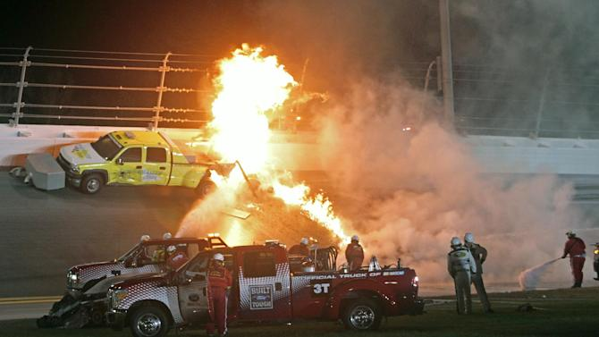 Feb. 27 Emergency workers try to put out a fire after Juan Pablo Montoya's car struck the truck during the NASCAR Daytona 500 auto race at Daytona International Speedway in Daytona Beach, Fla., Monday, Feb. 27, 2012. (AP Photo/Bill Friel)