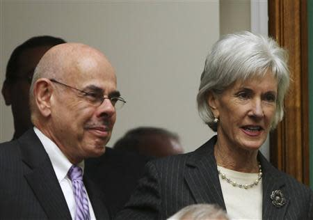 U.S. Health and Human Services Secretary Sebelius is greeted by Rep Waxman before testifying on Capitol Hill in Washington