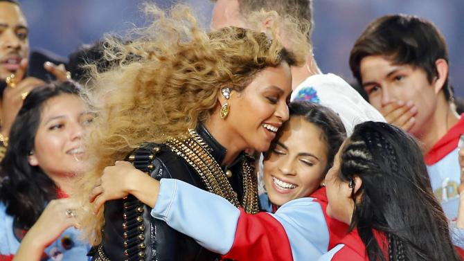 Beyonce hugs performers after performing in the half-time show during the NFL's Super Bowl 50 football game between the Carolina Panthers and the Denver Broncos in Santa Clara