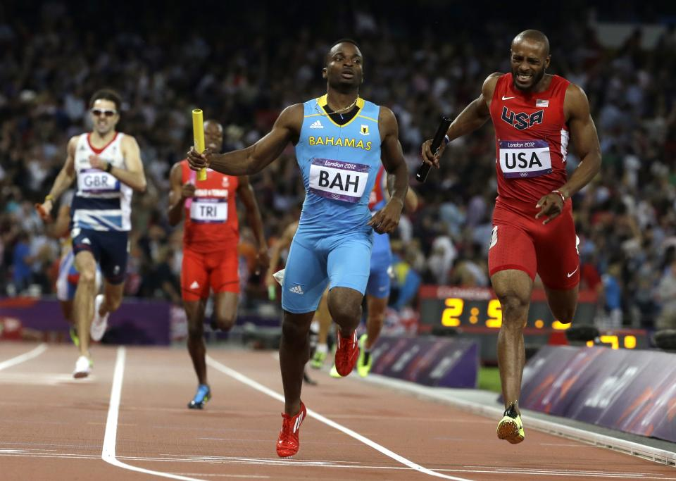 Bahamas' Ramon Miller beats United States'  Angelo Taylor across the line to win the men's 4 x 400-meter relay during the athletics in the Olympic Stadium at the 2012 Summer Olympics, London, Friday, Aug. 10, 2012. (AP Photo/Anja Niedringhaus)