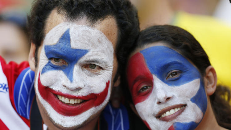 Chile's fans wait for the beginning of the World Cup round of 16 soccer match between Brazil and Chile at the Mineirao Stadium in Belo Horizonte, Brazil, Saturday, June 28, 2014. (AP Photo/Frank Augstein)