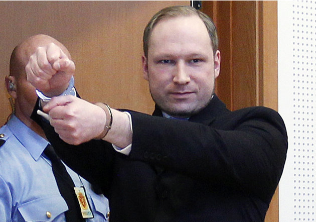 FILE -  In this Feb. 6, 2012 file photo, Anders Behring Breivik, a right-wing extremist who confessed to a bombing and mass shooting that killed 77 people on July 22, 2011, gestures as he arrives for 