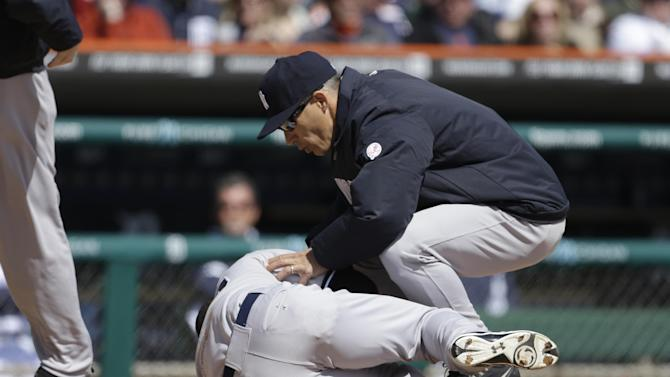 New York Yankees manager Joe Girardi looks over Eduardo Nunez after he was hit by a pitch from Detroit Tigers starting pitcher Doug Fister during the fourth inning of a baseball game in Detroit, Friday, April 5, 2013. (AP Photo/Carlos Osorio)