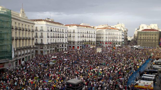 FILE - In this May 12, 21012 file photo, protesters pack the Puerta del Sol plaza in central Madrid. Worldwide growth was slack again in 2012. The global economy grew just 3.3 percent, down from 3.8 percent in 2011 and 5.1 percent in 2010, the International Monetary Fund estimates. (AP Photo/Paul White, File)