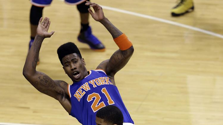 Indiana Pacers forward Paul George, right, is fouled by New York Knicks forward Iman Shumpert (21) during the first quarter of Game 6 of the Eastern Conference semifinal NBA basketball playoff series in Indianapolis, Saturday, May 18, 2013. (AP Photo/Michael Conroy)