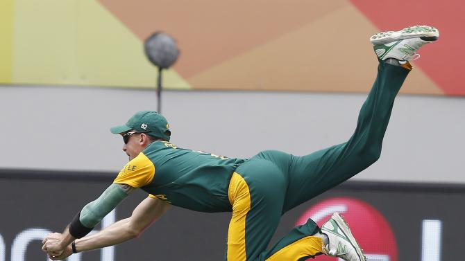 South Africa's Dale Steyn takes a catch to dismiss Pakistan's Ahmed Shahzad during the Cricket World Cup match in Auckland