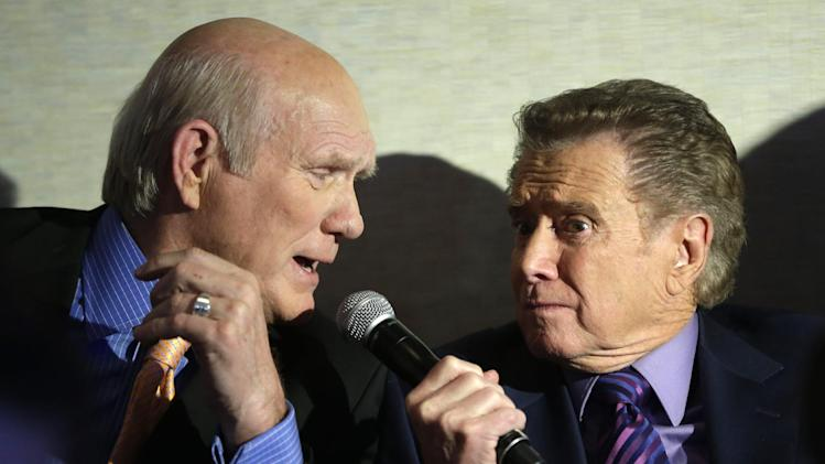 Regis Philbin, right, jokes with Terry Bradshaw during a news conference about Fox's new sports network in New York, Tuesday, March 5, 2013. Philbin will host a weekday sports talk show for the network's new channel Fox Sports 1. (AP Photo/Seth Wenig)