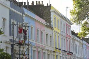 Scaffolders work on a residential street in Notting Hill in central London