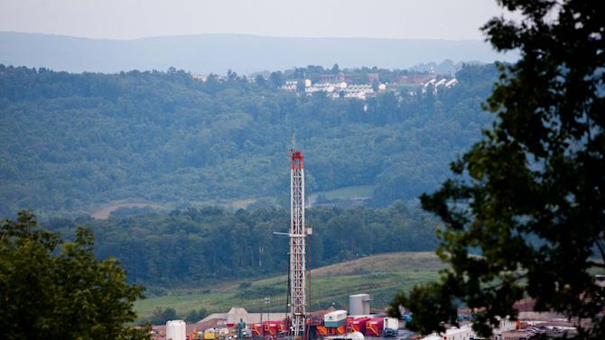 FILE - This Saturday, Aug.  6, 2011 photo shows a natural gas well operated by Northeast Natural Energy in Morgantown, W.Va. The well is the subject of a dispute over a drilling ban recently enacted by the city of Morgantown, which is directly across the Monongahela River from the well. On Wednesday, April 11, 2012, the price of natural gas has fallen to its lowest level in more than a decade, a remarkable decline for a commodity that not long ago was believed to be in short supply. Natural gas production has boomed across the country as energy companies employ a new drilling technique to tap previously untouched reserves. The process has raised concerns about water safety, and has been temporarily banned in New York and New Jersey. But where it has been allowed, it has led to increases in drilling, job growth and production. (AP Photo/David Smith)