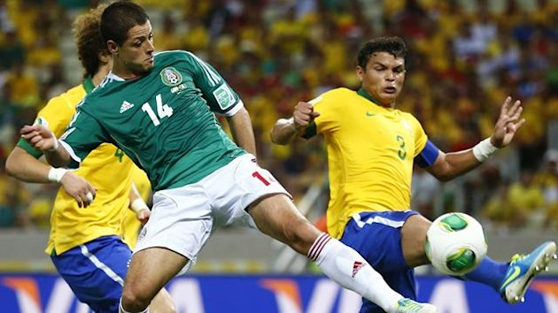 Mexico's Javier Hernandez (C) fights for the ball with Brazil's David Luiz and Thiago Silva during their Confederations Cup Group A soccer match at the Estadio Castelao in Fortaleza June 19, 2013. (Reuters)