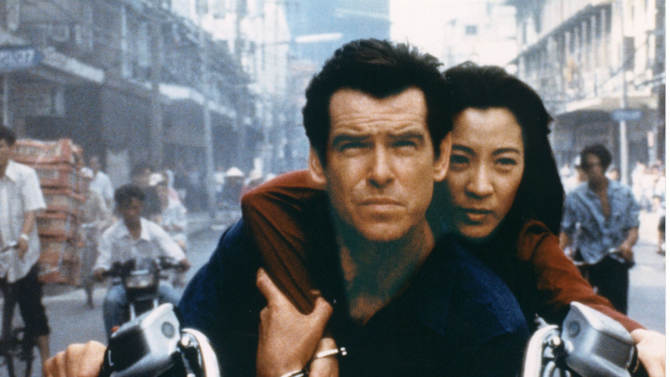 """FILE - This undated publicity file photo provided by BMW, shows Pierce Brosnan, as Bond, and Michelle Yeoh, as the Bond-girl, Wai Lin, in a scene from the James Bond 1997 movie """"Tomorrow Never Dies.""""  Who qualifies as a Bond girl has also changed over the years, as the blue-eyed, buxom blonde has given way to more diverse leading ladies, including Michelle Yeoh (""""Tomorrow Never Dies"""") and Halle Berry (""""Die Another Day""""). Modern Bond girls also present a more formidable challenge to the suave secret agent. (AP Photo/BMW)"""