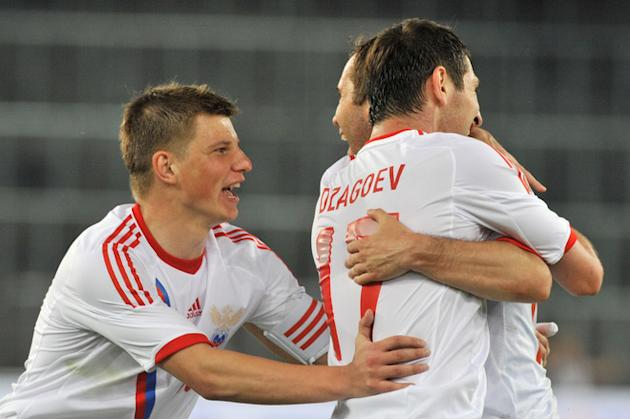 Russia's Dzagoev (R), Kerzhakov (M) And Captain Arshavin (L) Celebrate  AFP/Getty Images