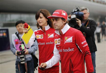Ferrari Formula One driver Fernando Alonso of Spain arrives for a news conference ahead of the Chinese F1 Grand Prix at the Shanghai International Circuit